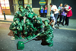 © Licensed to London News Pictures . 27/12/2016 . Wigan , UK . Men dressed as toy soldiers . Revellers in Wigan enjoy Boxing Day drinks and clubbing in Wigan Wallgate . In recent years a tradition has been established in which people go out wearing fancy-dress costumes on Boxing Day night . Photo credit : Joel Goodman/LNP