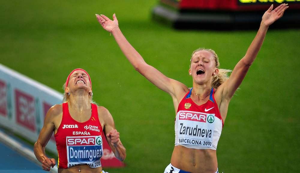 Russia's Yuliya Zarudneva (R) reacts after wining the women's 3000m steeplechase final ahead of Spain's Marta Dominguez at the 2010 European Athletics Championships at the Olympic Stadium in Barcelona.