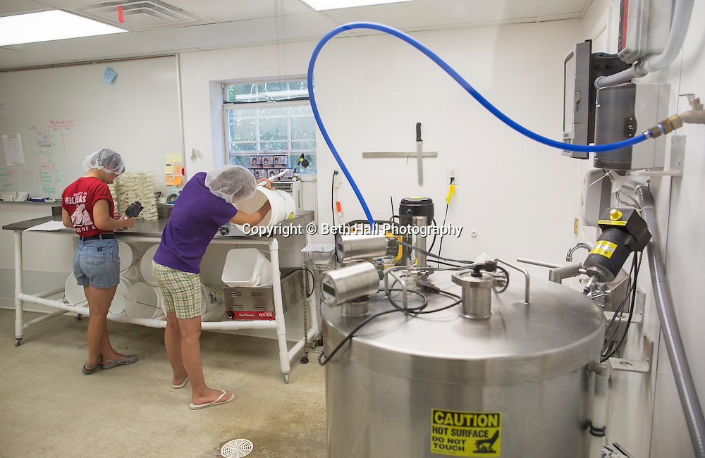 Employees package cheese at White River Creamery on Friday, June 20, 2014 in Elkins, Ark.<br /> <br /> Photo by Beth Hall