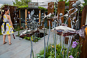 Metal fish on the Ian Gill Sculptures Stand - The Chelsea Flower Show organised by the Royal Horticultural Society with M&G as its MAIN sponsor for the final year. London 23 May, 2017