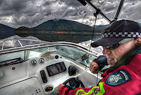 Mitta Mitta, one policeman town. Following the working life of Leading Senior Constable John Kissane. On Lake Dartmouth with Water Police Leading Senior Constable Brett Tanian. Pic By Craig Sillitoe CSZ/The Sunday Age.27/03/2012 This photograph can be used for non commercial uses with attribution. Credit: Craig Sillitoe Photography / http://www.csillitoe.com<br /> <br /> It is protected under the Creative Commons Attribution-NonCommercial-ShareAlike 4.0 International License. To view a copy of this license, visit http://creativecommons.org/licenses/by-nc-sa/4.0/.