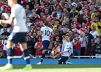Football - 2019 / 2020 Premier League - Arsenal vs. Tottenham Hotspur<br /> <br /> Christian Eriksen (Tottenham FC) sinks to his knees after scoring the opening goal at The Emirates.<br /> <br /> COLORSPORT/DANIEL BEARHAM