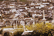 White crosses of cemetery and white-washed houses in Baena, Spain.