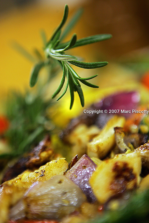 """A piece of rosemary sits atop a plate of roasted vegetables to be set out for a """"family-style"""" dinner on Thursday February 1, 2007. The 1,500 acre Home Ranch in Clark, Colo. is a high-end dude ranch by summer and a cross country skiing and snowshoeing paradise in the winter. The Home Ranch also welcomes guests with world-class dining at the all-inclusive ranch near Steamboat Springs. The ranch has been open since 1980 and rates in the winter range from $420/night for a room in the lodge to $525/night for a cabin..(MARC PISCOTTY/ © 2006) CQ"""