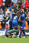 Plymouth Argyle's Kelvin Mellor collapses to the ground as Wimbledon players celebrate at the final whistle of the Sky Bet League 2 play off final match between AFC Wimbledon and Plymouth Argyle at Wembley Stadium, London, England on 30 May 2016.