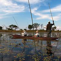 Africa, Botswana, Okavango Delta. Safari by mokuru through Moremi waterways.
