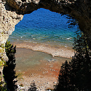"""""""Life Below Arch Rock""""<br /> <br /> Beautiful and scenic Arch Rock on Mackinac Island, Michigan. Down below you can see people writing with stones on the shore."""