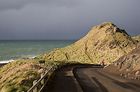 Stormy weather approaching the road leading to The Giants Causeway landmark in Antrim Northern Ireland