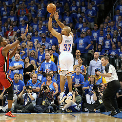 Jun 12, 2012; Oklahoma City, OK, USA;  Oklahoma City Thunder point guard Derek Fisher (37) shoots a three point shot over Miami Heat power forward Chris Bosh (1) during the first quarter of game one in the 2012 NBA Finals at the Chesapeake Energy Arena.  Mandatory Credit: Derick E. Hingle-US PRESSWIRE