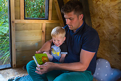 Dad of two Tom Prior has created a beautiful shingle clad, two floor play house in the garden of his Shoreham, West Sussex home for his children. Jackson, 4, and his Dad enjoy some quality time in the playhouse. Shoreham, West Sussex, July 15 2019.