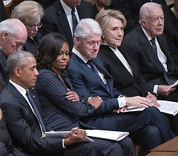 Former first lady Michelle Obama, second left, puts her hand on the arm of former US President Bill Clinton, center, as he gets emotional during the eulogies to former US President George H.W. Bush during the National funeral service in honor of the late former President at the Washington National Cathedral in Washington, DC on Wednesday, December 5, 2018. Also pictured are former US President Barack Obama, left, former US Secretary of State Hillary Rodham Clinton, second right, and former US President Jimmy Carter<br /> Photo by Ron Sachs / CNP/ABACAPRESS.COM