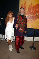 The MARQUESS OF BATH and MISS TRUDI JUGGERNAUT-SHARMA at the Sotheby's Summer Party 2007 at their showrooms in New Bond Street, London on 4th June 2007.<br />
