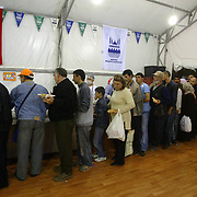 People getting their meals from the tent donated by the Eminonu Shop Owners Associtaion and Eminonu Municipulaty at the first day of Ramadan which is the holly fasting  season for the Muslims.   Saturday, 23.09.2006<br /> Photo by Aykut AKICI/TURKPIX