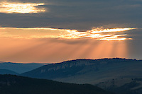 Crepuscular rays emerge from a cloud as the sun sets beyond Tongue River Canyon. This was the view from the top of Steamboat Point.