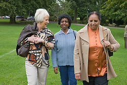 Group of older woman walking in the park,