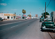 CS00427-01. South Central, Phoenix, Arizona. 1954. The South Central Outlet Store at 724 South Central is still standing and is the Queen Liquors Drive-Thru. Goettl Bros. Sheet Metal is  still standing.