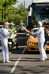 Olympic Torch reaches Sheffield Chapeltown/Ecclesfield/Parson Cross leg.<br /> Handover runner 101 Dana Abdulkarim (right) hands the flame on to Joshua McGill runner 102<br /> 25 June 2012.Image © Paul David Drabble