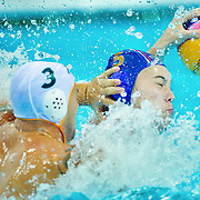Serbia's Dusan Mandic (right in blue cap) was defended by Australia's Tim Cleland (left) in men's water polo quarterfinal action at the Water Polo Arena in Olympic Park during the 2012 Summer Olympic Games in London, England, Wednesday, August 8, 2012. (David Eulitt//Kansas City StarMCT)