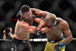 """Chris """"The All-American"""" Weidman (red gloves) vs. Ronaldo """"Jacare"""" Souza (blue gloves) during UFC 230 at Madison Square Garden."""
