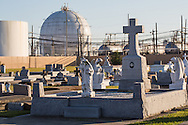 The Holy Rosary Cemetery on the bank of the Mississippi River in Lousiana, along a stretch between Baton Rouge and New Orleans know as Cancer Alley.