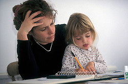 Woman trying to work from home but being interupted by her toddler daughter UK. MR