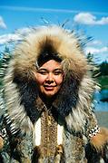Alaska, Anchorage, Alaska Native Heritage Center. Eskimo woman from King Island showing her hand-stitched fur parka.