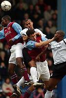 Photo. Javier Garcia<br />08/02/2003 Fulham v Aston Villa, FA Barclaycard Premiership, Loftus Road<br />Steve Marlet beats Ronnie Johnsen to the ball but heads over