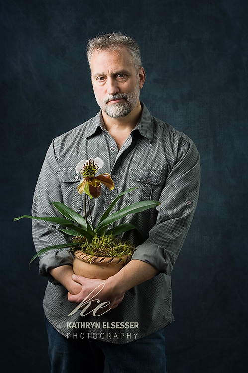 Business Portrait of Josef of Botanica Floral Design holding a potted orchid