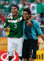 Photo: Glyn Thomas.<br />Mexico v Iran. Group D, FIFA World Cup 2006. 11/06/2006.<br /> Mexico's Carlos Salcido (L) and Oswaldo Sanchez celebrate their 3-1 victory.
