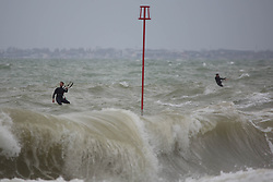 © Licensed to London News Pictures.  03/05/2021. Brighton, UK. Kite-surfers catch the wind along cost line of Brighton Beach in East Sussex, following The May Day, bank holiday as forecasts predict strong winds and rain for the coming week. Photo credit: Marcin Nowak/LNP