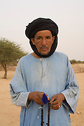 Tuareg nomad with Subha beads in his hands, in a desert camp around Timbuktu in Mali.