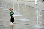 Children playing in the fountains at Somerset House in London, UK. The United Kingdom's national weather service forecast temperatures reaching a high of 21 degrees Celsius (69.8 degrees Fahrenheit) in London on Saturday. Unseasonally high spring temperatures for the time of year.