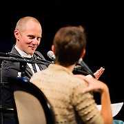 NHPR's Virginia Prescott interviews author Chris Cleave during a Writers on a New England Stage show at The Music Hall in Portsmouth, NH