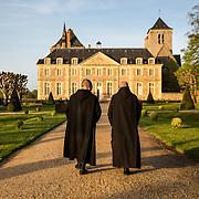 Two monks walking in the French garden facing the 18th century priory of Solesmes Abbey. 03-05-16<br /> Deux moines se promenant dans le jardin à la française faisant face au prieuré du XVIII e siècle de l'abbaye de Solesmes. 03-05-16