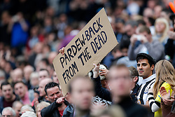 "Newcastle United fans hold a sign reading ""Pardew back from the dead' in response to the club's recent upturn in form - Photo mandatory by-line: Rogan Thomson/JMP - 07966 386802 -01/11/2014 - SPORT - FOOTBALL - Newcastle, England - St James' Park - Newcastle United v Liverpool - Barclays Premier League."