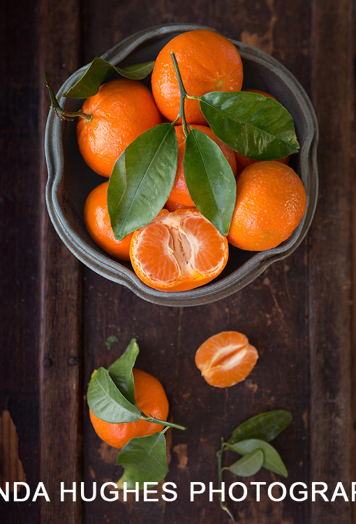 Overhead view of tangerines on a rustic wooden surface