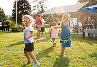 Cora Takantjas tries the hoola hoop at Sargent Park during Belmont Police Department's National Night Out on Tuesday evening.  (Karen Bobotas/for the Laconia Daily Sun)