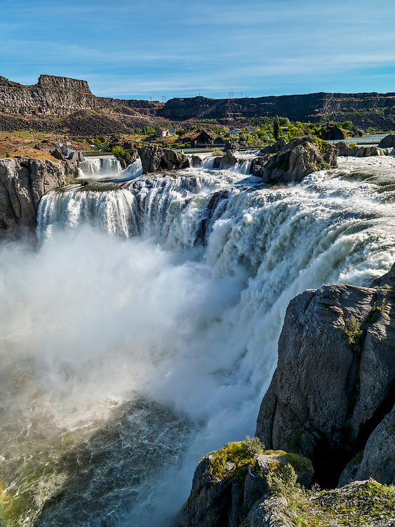 """Licensing - Open Edition Prints<br /> Shoshone Falls is a waterfall on the Snake River located approximately five miles east of Twin Falls, Idaho. Sometimes called the """"Niagara of the West,"""" Shoshone Falls is 212 feet (64.7 m) high—45 feet (14 m) higher than Niagara Falls—and flows over a rim 1,000 feet (305 m) wide. Shoshone Falls has existed at least since the end of the last ice age, when the Bonneville Flood carved much of the Snake River canyon and surrounding valleys. It is a total barrier to the upstream movement of fish. The falls were the upper limit of sturgeon, and spawning runs of salmon and steelhead could not pass the falls. Yellowstone cutthroat trout lived above the falls in the same ecological niche as Rainbow Trout below it. Due to this marked difference, the World Wide Fund for Nature used Shoshone Falls as the boundary between the Upper Snake and the Columbia Unglaciated freshwater ecoregions."""