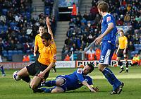 Photo: Steve Bond/Richard Lane Photography. <br />Leicester City v Hull City. Coca Cola Championship. 21/03/2008. Simon Walton (L) is brought down by Matt Oakley (C)