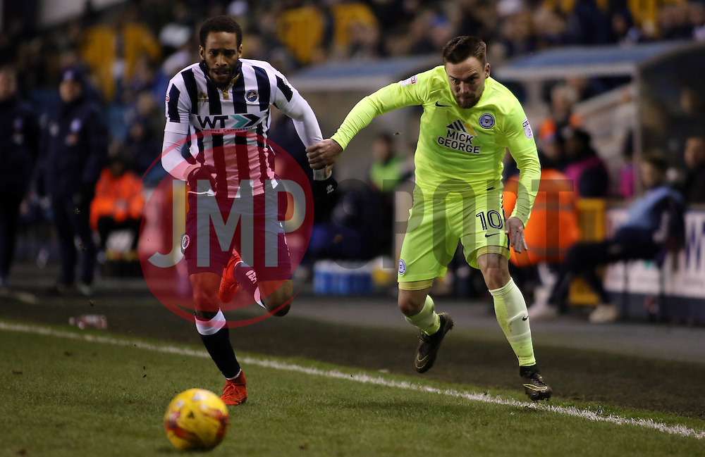 Paul Taylor of Peterborough United gets away from Shaun Cummings of Millwall - Mandatory by-line: Joe Dent/JMP - 28/02/2017 - FOOTBALL - The Den - London, England - Millwall v Peterborough United - Sky Bet League One