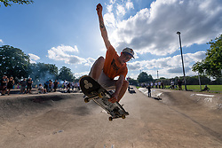 © Licensed to London News Pictures. 14/08/2021. London, UK. Skateboarders take part in the Harrow Skate Park Jam event. The concrete skate park, a. k. a Solid Surf, was built and opened on 15th July 1978. It is one of two remaining skate parks built in the 1970's. There are plans for Harrow Council to redevelop the skate park and surrounding area. Editorial Usage only. Photo credit: Ray Tang/LNP