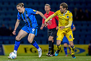 Gillingham FC forward Tom Eaves (9) and Bristol Rovers midfielder Ed Upson (6)  during the EFL Sky Bet League 1 match between Gillingham and Bristol Rovers at the MEMS Priestfield Stadium, Gillingham, England on 12 March 2019.