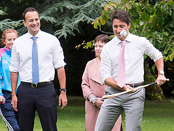 Prime Minister Justin Trudeau tries his hand at hurling as Irish Taoiseach Leo Varadkar looks on at Farmleigh House Tuesday, July 4, 2017 in Dublin, Ireland. Photo by Ryan Remiorz/CP/ABACAPRESS.COM