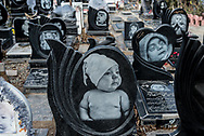 Tehran. Iran.  Behesht-e Zahra Children cemetery is a very strange place where you can see the portraits of the dead children alived