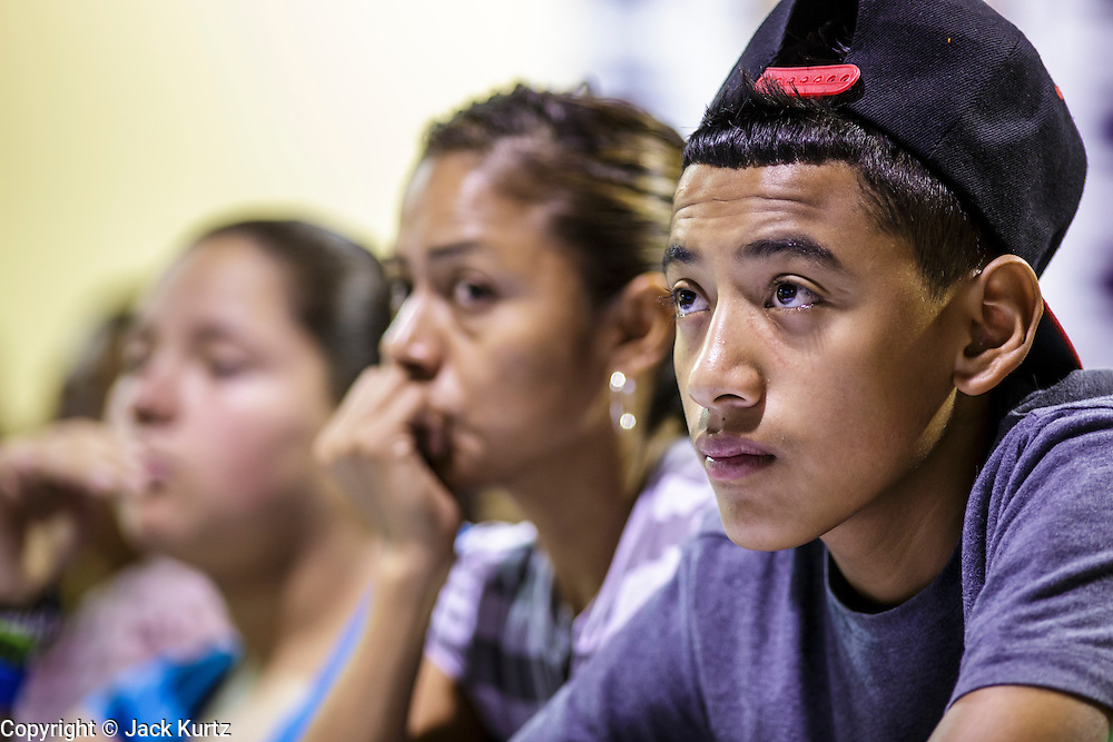 """18 AUGUST 2012 - PHOENIX, AZ: Young people who hope to be granted """"deferred action"""" status listen to speakers at a deferred action workshop in Phoenix. More than 1000 people attended a series of 90 minute workshops in Phoenix Saturday on the """"deferred action"""" announced by President Obama in June. Under the plan, young people brought to the US without papers, would under certain circumstances, not be subject to deportation. The plan mirrors some aspects the DREAM Act (acronym for Development, Relief, and Education for Alien Minors), that immigration advocates have sought for years. The workshops were sponsored by No DREAM Deferred Coalition.  PHOTO BY JACK KURTZ"""