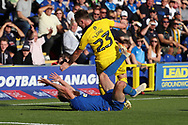 AFC Wimbledon midfielder Scott Wagstaff (7) going down in the box during the EFL Sky Bet League 1 match between AFC Wimbledon and Oxford United at the Cherry Red Records Stadium, Kingston, England on 29 September 2018.