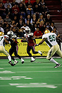 4/12/2007 - Dawon Gentry (2) tries to find a hole on a kick off return in the The Alaska Wild 33-46 loss to the visiting Frisco Thunder in the first professional football game in Alaska.