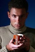 Male model drinking coffee portrait, studio