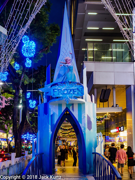 """12 DECEMBER 2018 - SINGAPORE:  The castle from """"Frozen"""" in a Christmas display on Orchard Road. Orchard Road is the main shopping district of Singapore and for years hosts a large light display around Christmas. The main sponsor of this year's display is the Disney Company and the displays are decorated with characters from the Disney entertainment universe. This has upset some religious leaders in Singapore and the National Council of Churches of Singapore (NCCS) sent a letter to the Singapore Tourism Board (STB) expressing its concern about the """"increasing secularisation and commercialization of Christmas"""" in Singapore. The STB reached out to the NCCS, but the Orchard Road lights will remain on through the holidays.   PHOTO BY JACK KURTZ"""