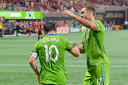 July 15, 2018 - Atlanta, GA, U.S. - ATLANTA, GA Ð JULY 15:  Seattle's Nicol‡s Lodeiro (10) is congratulated by teammate Will Bruin (17) after scoring on a penalty kick during the match between Atlanta and Seattle on July 15th, 2018 at Mercedes-Benz Stadium in Atlanta, GA.  Atlanta United FC and Seattle Sounders FC played to a 1 Ð 1 draw. (Photo by Rich von Biberstein/Icon Sportswire) (Credit Image: © Rich Von Biberstein/Icon SMI via ZUMA Press)